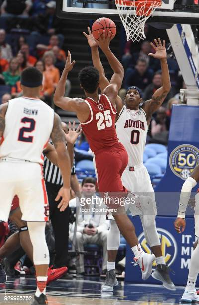 Alabama forward Braxton Key shoots over Auburn forward Horace Spencer in the first half during a Southeastern Conference Basketball Tournament game...