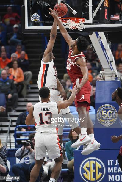 Alabama forward Braxton Key tries to block a shot by Auburn forward Daniel Purifoy during a Southeastern Conference Basketball Tournament game...