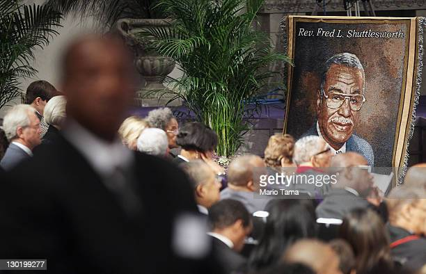 Alabama Gov Robert Bentley speaks behind the body of deceased civil rights icon Fred Shuttlesworth during his funeral at Faith Chapel Christian...