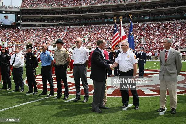 Alabama Governor Robert Bentley thanks the Tuscaloosa County first responders for their help during the April 27th tornadoes before the game with the...