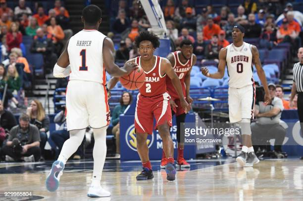 Alabama guard Collin Sexton comes up to challenge Auburn guard Jared Harper during a Southeastern Conference Basketball Tournament game between...