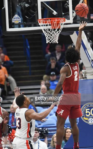 Alabama guard Collin Sexton puts up a shot as aa134 looks on during a Southeastern Conference Basketball Tournament game between Auburn and Alabama...