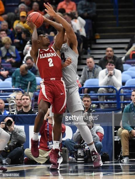 Alabama guard Herbert Jones tries to tie up Alabama guard Collin Sexton during a Southeastern Conference Basketball Tournament game between Alabama...
