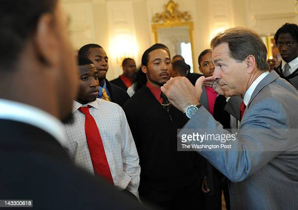 Alabama head football coach Nick Saban reminds Dunbar High School football players that they have reached an upper level of play while visiting the...