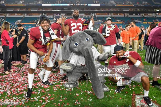 Alabama players pose with Alabama mascot Big Al after the winners ceremony of the CFP Semifinal at the Orange Bowl between Alabama Crimson Tide and...