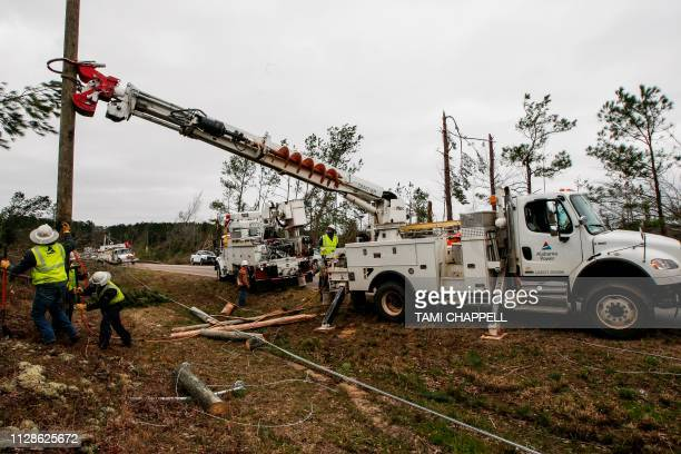 Alabama Power begins putting up poles March 4 2019 to get power restored in Beauregard Alabama after a tornado Rescuers in Alabama resumed search...
