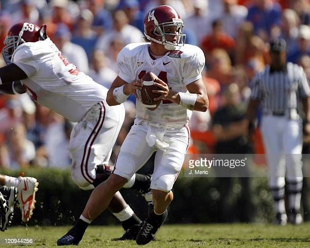 Alabama quarterback John Parker Wilson looks for an open receiver in Saturday's game against Florida at Ben Hill Griffin Stadium in Gainesville,...