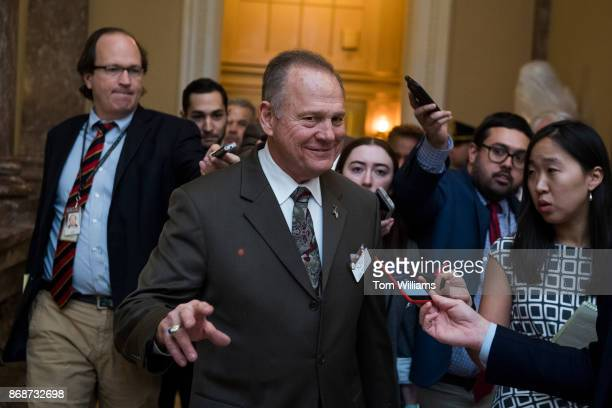 Alabama Republican Senate nominee Roy Moore is questioned by the media in the Capitol on October 31 2017