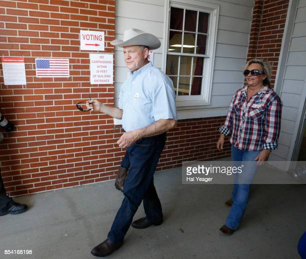 Alabama Republican US Senate candidate Roy Moore and wife Kayla leave the Gallant Fire Hall after voting in today's GOP runoff election September 26...