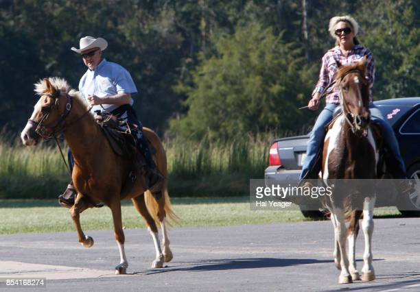 Alabama Republican US Senate candidate Roy Moore on Sassy and wife Kayla on Sundance ride their horses to the Gallant Fire Hall to vote in today's...