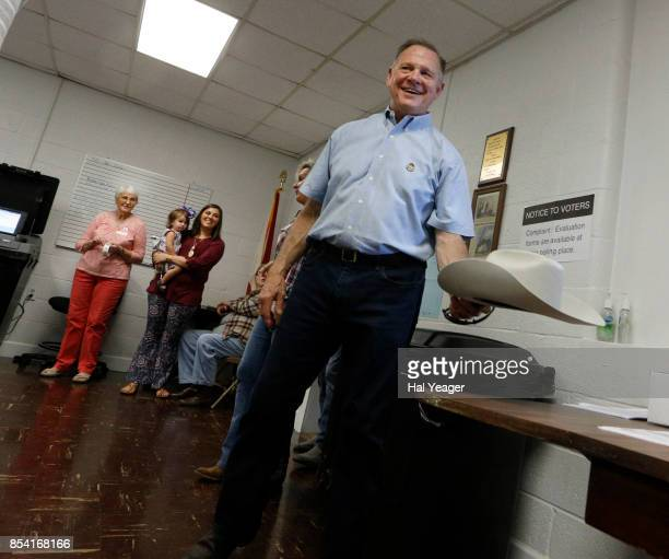 Alabama Republican US Senate candidate Roy Moore places his hat on a table as he enters the Gallant Fire Hall to vote in today's GOP runoff election...