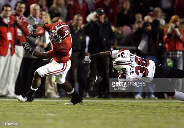 Alabama running back Mark Ingram eludes South Carolina freshman cornerback DJ Swearinger on a secondquarter run at BryantDenny Stadium in Tuscaloosa...