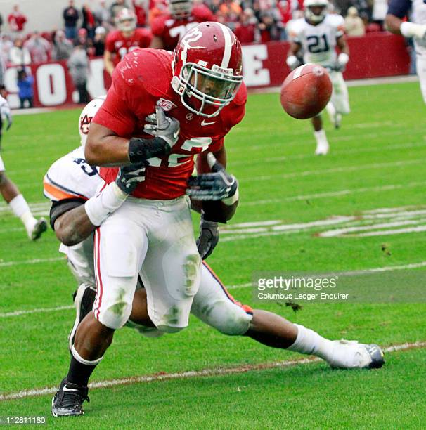 Alabama running back Mark Ingram is hit by Auburn's Antione Carter and loses the ball into the end zone for a touchback at Bryant-Denny Stadium in...