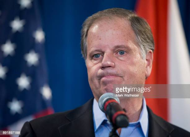 Alabama senatorelect Doug Jones listens to a question during a December 13 2017 in Birmingham Alabama Jones stated that US President Donald Trump...