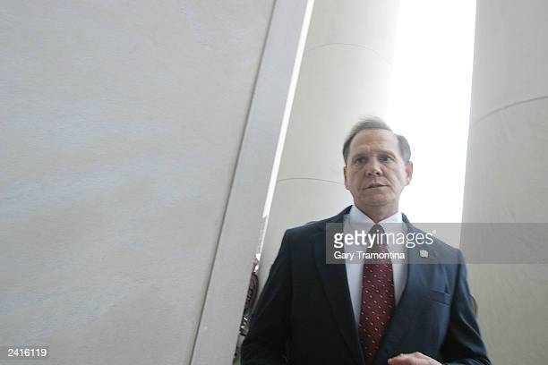 Alabama Supreme Court Chief Justice Roy Moore walks back into the state Judicial Building after addressing supporters August 21 2003 in Montgomery...