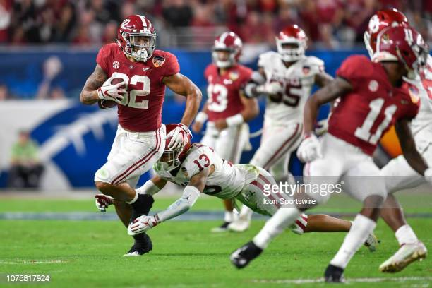 Alabama tight end Irv Smith Jr tries to run away from the tackle by Oklahoma cornerback Tre Norwood after a reception during the second half of the...
