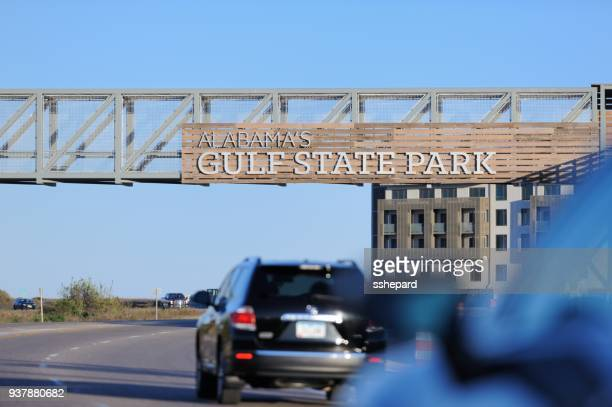 alabama's gulf state park sign on walkway over road - gulf shores alabama stock pictures, royalty-free photos & images