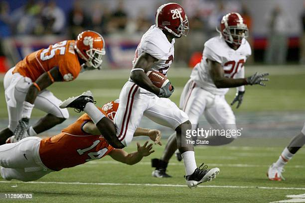 Alabama's Javier Arenas returns the opening kick past Clemson's Mark Bucholz in the first quarter of the ChickFilA College Kickoff at the Georgia...