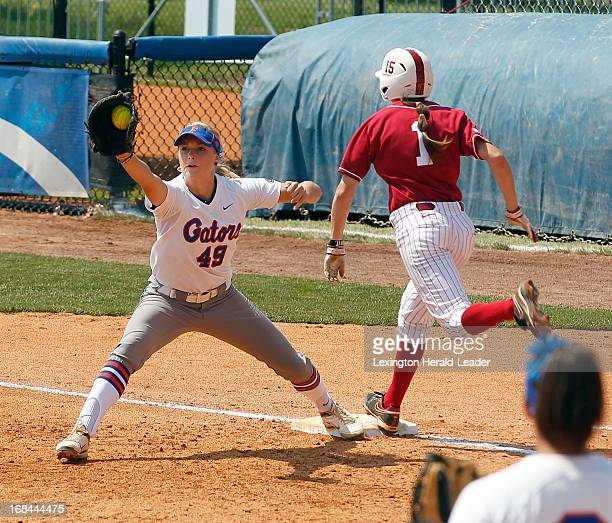 Alabama's Kayla Braud beat out the throw for an infield single in the top of the 3rd inning against Florida first baseman Taylor Schwarz in the SEC...