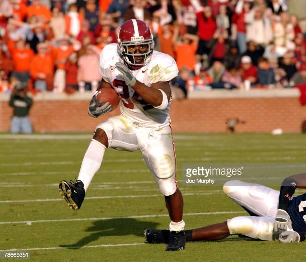 Alabama's Kenneth Darby dodges an Auburn tackler during the first half at JordanHare Stadium Auburn Alabama Nov 19 2005