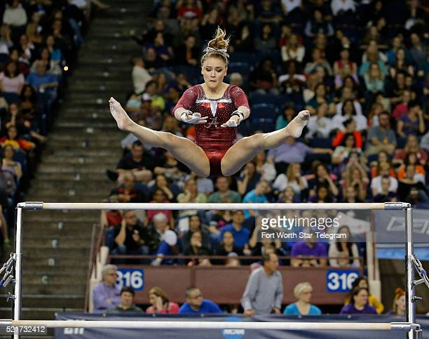 Alabama's Mackenzie Brannan on the uneven parallel bars in the Super Six finals during the NCAA Women's Gymnastics Championships at the Fort Worth...