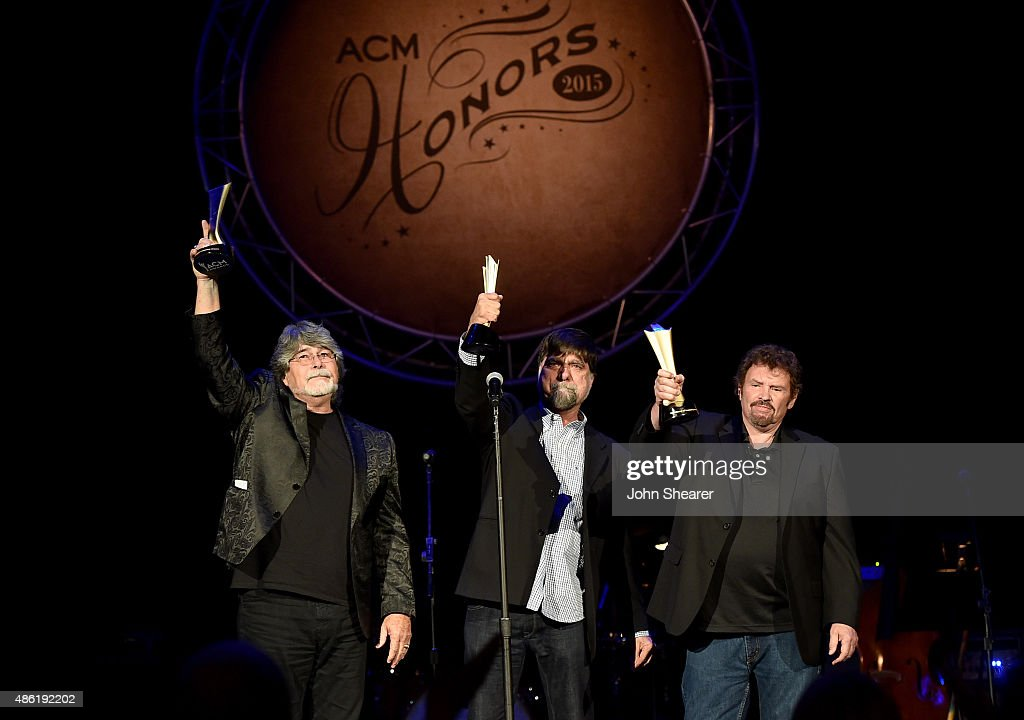 Alabama's Randy Owen, Teddy Gentry, and Jeff Cook accept the Career Achievement Award during the 9th Annual ACM Honors at the Ryman Auditorium on September 1, 2015 in Nashville, Tennessee.