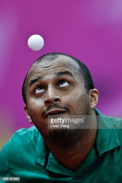 Alabbad Abdulaziz Abbad M of Saudi Arabia competing against Li Hu of Singapore in Table Tennis Men's Team Preliminary Round Group A during day eight...