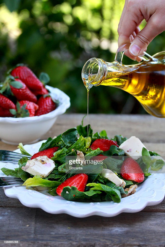 Alad Of Spinach Strawberries Cheese And Olive Oi High-Res ...