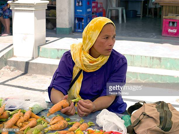 Aladipina Limpoan selling homegrown carrots on the women farmers group communal market stall in Alamada Cotabato province Mindanao Island The...