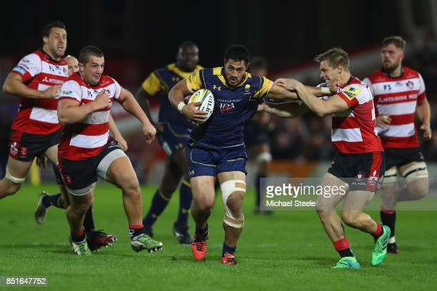 Alafoti Faosiliva of Worcester hands off Jason Woodward of Gloucester as Val Rapava Ruskin closes iduring the Aviva Premiership match between...