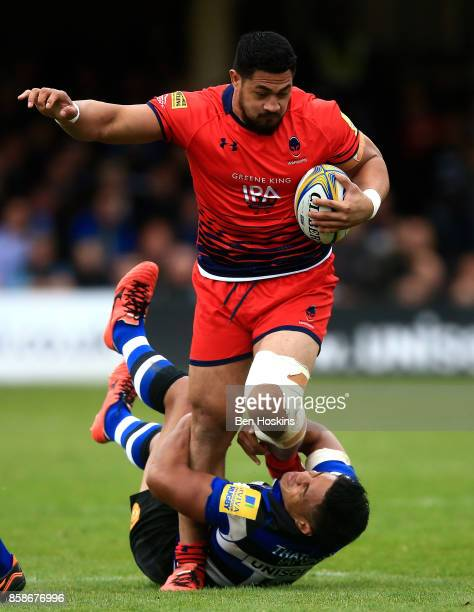 Alafoti Faosiliva of Worcester is tackled by Ben Tapuai of Bath during the Aviva Premiership match between Bath Rugby and Worcester Warriors at...