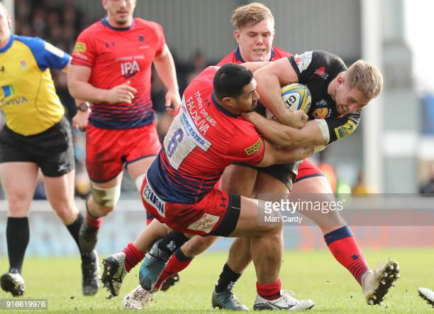 Alafoti Faosiliva of Worcester Rugby tackles Sam Hill of Exeter Chiefs during the Aviva Premiership match between Exeter Chiefs and Worcester...