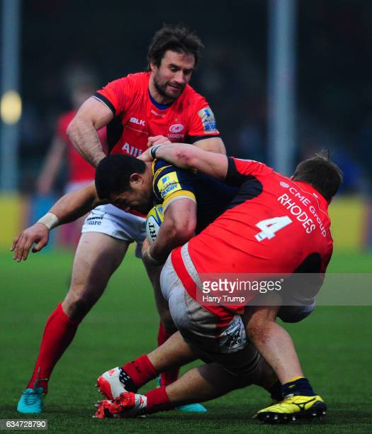 Alafoti Faosiliva of Worcester Warriors is tackled by Michael Rhodes of Saracens during the Aviva Premiership match between Worcester Warriors and...