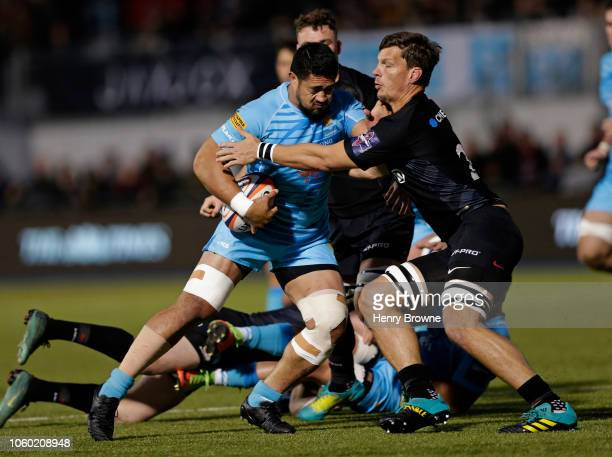 Alafoti Fa'Osiliva of Worcester Warriors is tackled by Mike Rhodes of Saracens during the Premiership Rugby Cup match between Saracens and Worcester...