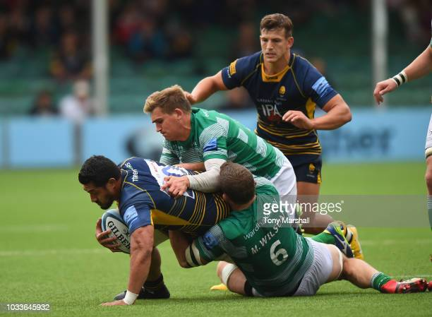 Alafoti Faosiliva of Worcester Warriors is tackled by Toby Flood and Mark Wilson of Newcastle Falcons during the Gallagher Premiership Rugby match...