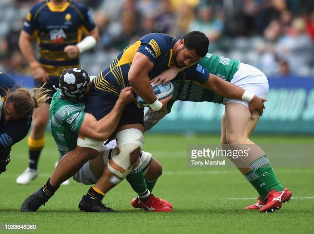 Alafoti Faosiliva of Worcester Warriors is tackled byGary Graham and Adam Brocklebank of Newcastle Falcons during the Gallagher Premiership Rugby...