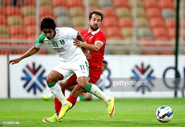 AlAhli of Saudi Arabia's Hussain alMoqahwi vies with AlAhli Dubai's Everton Rebeiro during their AFC champions league football match Saudi Arabia's...