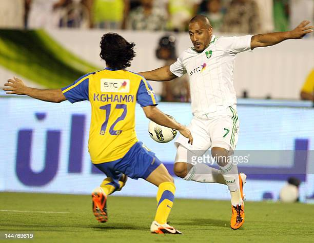 AlAhli player Victor Simoes de Oliveira of Brasil fights for the ball with AlNasr player Khaled Ahmed alGhamdi during the Saudi King Cup of Champions...