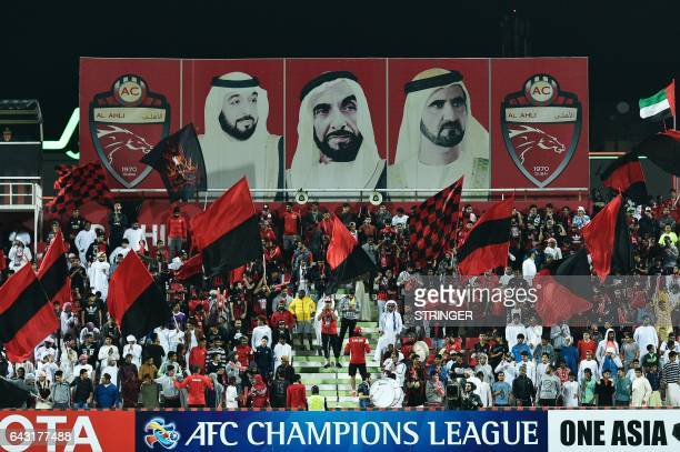 AlAhli supporters attend the AFC Champions League qualifying football match between UAE's AlAhli and Iran's Esteghlal FC at AlRashid Stadium in Dubai...
