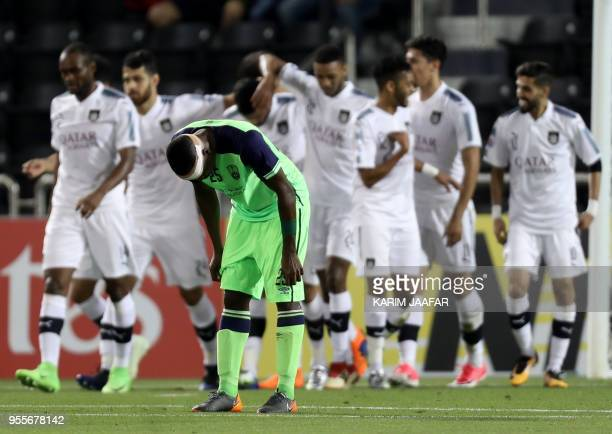 AlAhli's defender Motaz Hawsawi reacts after AlSadd scored a goal during the AFC Champions League football match between Qatar's AlSadd club and...