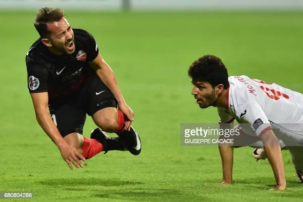 Al-Ahli's midfielder from Brasil Everton Ribeiro is tackled by Lokomotiv Tashkent's midfielder from Georgia Masharipov Jaloliddin during the AFC...