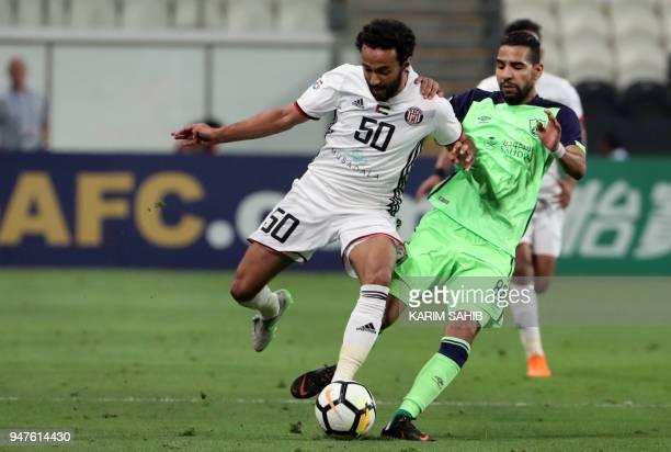 AlAhli's midfielder Moamen Zakaria vies for the ball with AlJazira's midfielder Mohammed Jamal during their AFC Champions League match between...