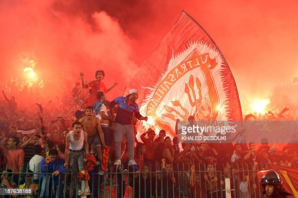 AlAhly Egyptian fans celebrate in Cairo on November 10 2013 after their team defeated South Africa's Orlando Pirates 20 in the CAF Champions League...