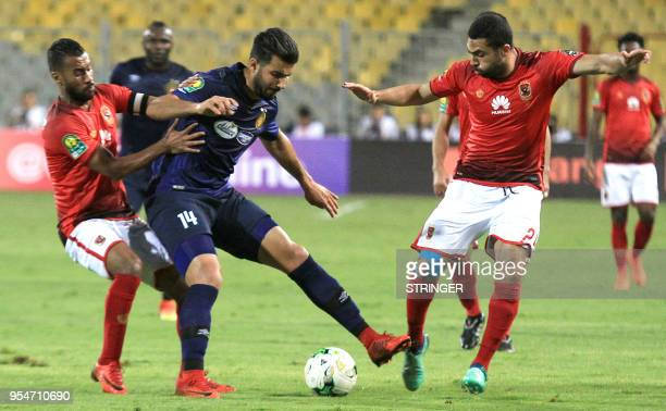 AlAhly FC's Egyptian defender Ahmed Fathy vies for the ball against ES Tunis' Tunisian striker Haythem Jouini during their CAF Champions League group...