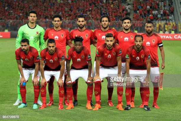 AlAhly FC's starting eleven pose for a group picture ahead of their CAF Champions League group A match against ES Tunis at Borg alArab Stadium near...