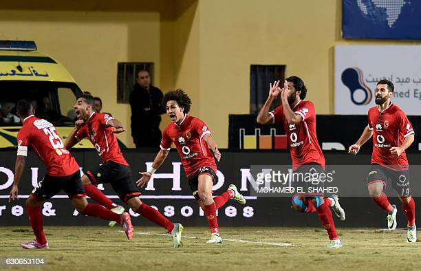 AlAhly players celebrate after scoring a goal during their Egyptian Premier League football match against Zamalek at the Petrosport Stadium in Cairo...