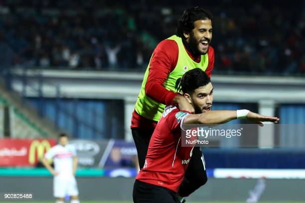 AlAhly players Walid Azaro and Marwan Mohsen celebrate after scoring a goal during the Egypt Premier League Fixtures 17 match between Al Ahly and...