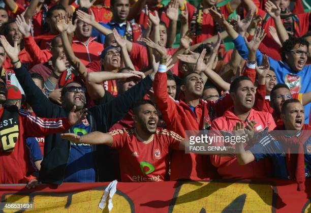 AlAhly SC supporters cheer their team ahead of their FIFA Club World Cup quarter final football match against Guangzhou Evergrande FC in the coastal...