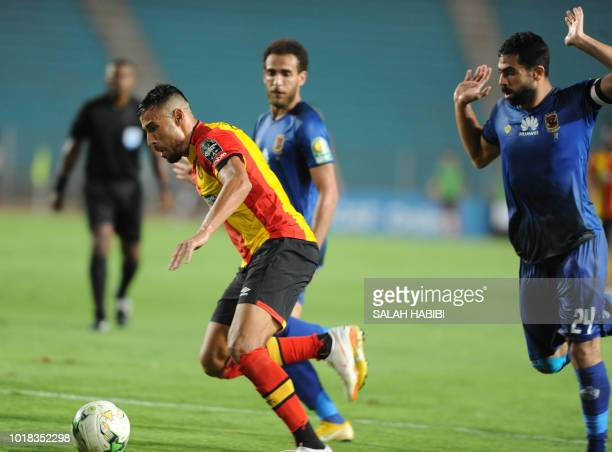 AlAhly SC's Egyptian midfielder Ahmed Fathy vies for the ball against ES Tunis' Tunisian forward Anice Badri during the CAF Champions League group A...