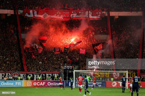 AlAhly supporters cheer during the CAF Champions League semifinal football match between AlAhly vs Etoile du Sahel at the Borg El Arab Stadium in...